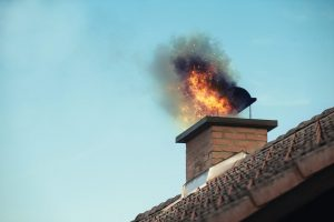 Exterior House Chimney Fire Preparedness and Prevention House Fire Hazards Burned Surge Protector Fire Smoke Water Damage Restoration DRS Disaster Restoration Services of Portland, Middletown, New Britain, New Haven, Norwich, CT, Springfield, Chicopee, Worcester, Framingham, MA, and Providence, Warwick, Taunton, and Fall River, RI